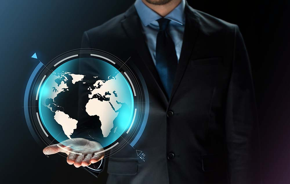 close up of businessman in suit with earth projection